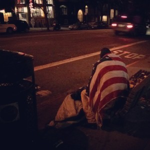 homeless man in flag